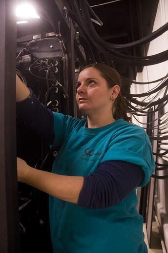 audio visual consultant working on audio rack